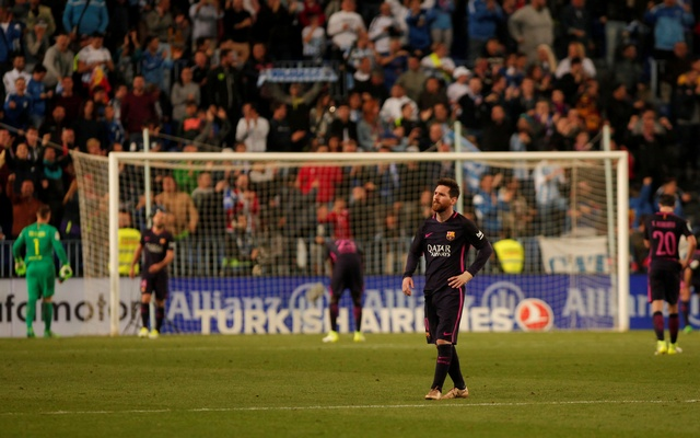 5+Lionel+Messi+reacts+after+Malaga's+second+goal.