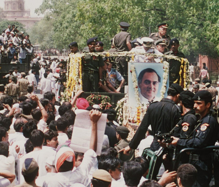 (Files) A 24 May 1991 file photo showing the funeral procession for slain prime minister Rajiv Gandhi moving through the crowded streets of New Delhi. Gandhi was was killed by a suicide bomber in Sriperumbudur, Tamil Nadu State during a campaign visit. AFP PHOTO Douglas E. CURRAN