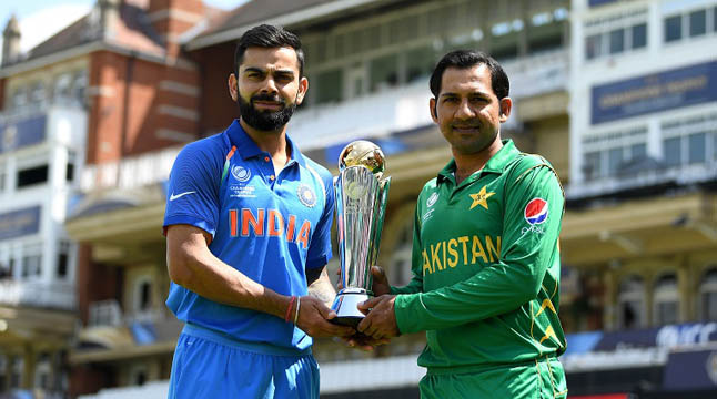 LONDON, ENGLAND - JUNE 17:  India captain Virat Kohli and Pakistan captain Sarfraz Ahmed hold the ICC Champions Trophy ahead of tomorrow's final at The Kia Oval on June 17, 2017 in London, England.  (Photo by Gareth Copley/Getty Images)